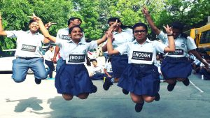 A group of indian students jumping for joy ahead of global week for action on NCD
