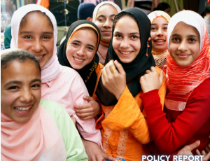 a group of middle eastern girls smiling at the camera