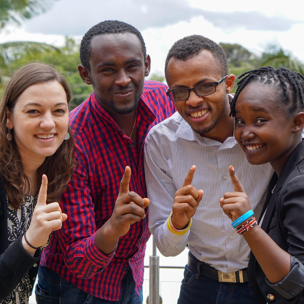 four NCD Child young leaders smiling