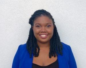 African American girl wearing blue jacket smiling